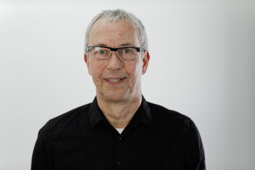 Dirk Baranek Porträtfoto in schwarzem Hemd